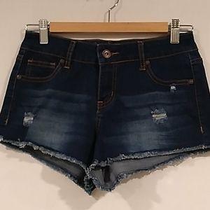 Wax jeans•distressed cutoff raw hem jean shorts